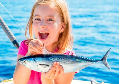 Young Girl holidng Fish on Catamaran, Royal Charters